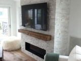 Snow White Marble Ledger Panels around fireplace Fremont