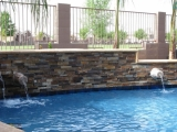 California Gold ledger stone veneer panels outdoor waterfall retaining wall