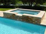 Golden white stacked stone raised spa travertine coping Carmel California