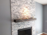 Alaska Gray Marble around fireplace stone veneer panels Fremont