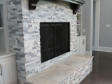 White marble around fireplace stone wall stacked ledger San Mateo