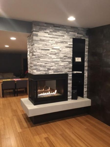 white marble graystone stacked panels on indoor fireplace tile wall