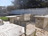 Golden Honey ledger stacked stone veneer outdoor kitchen wall