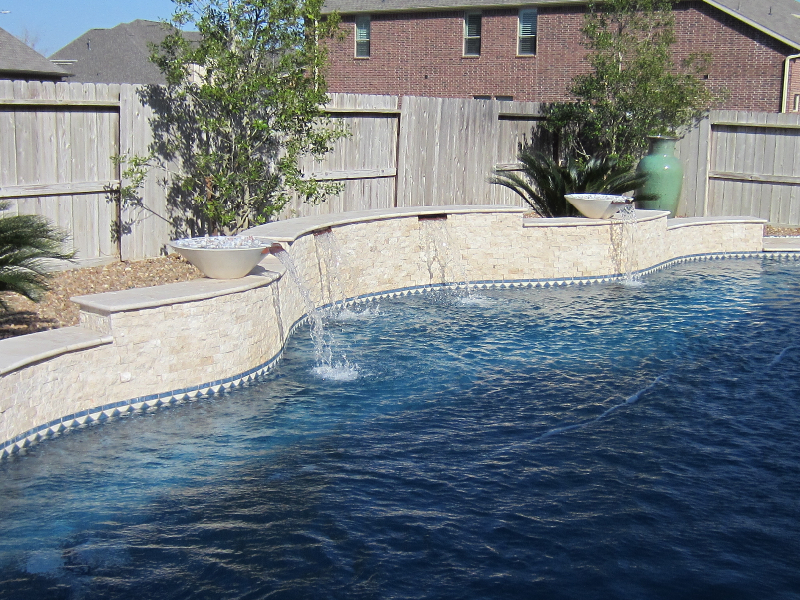 Ivory light travertine pool coping stone veneer split face retaining wall San Ramon California